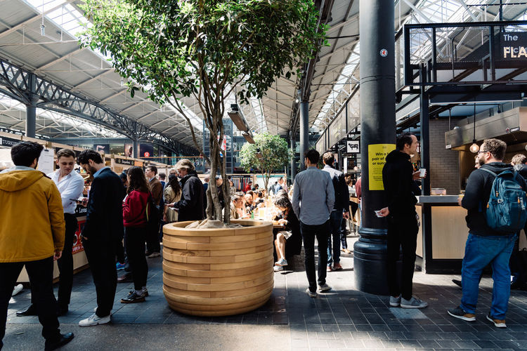 Old Spitalfields market with unidentified people enjoying street food. The market hosts arts and craft and street food market. Brexit Britain London Uk Antique Architecture Beautiful British Building Business City Culture Destination England English Europe European  Flea Food Foodie Gastro Handcrafted Interior KINGDOM Landmark Market Marketplace Merchandise Old People Retail  Retro Revival Shop Shopping Shoreditch Spitalfields Stall Store Street Street Food Tourism Tourist Town Travel Vintage Whitechapel
