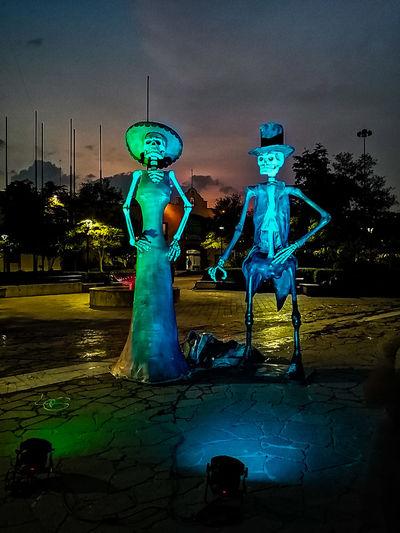 Illuminated sculpture against blue sky