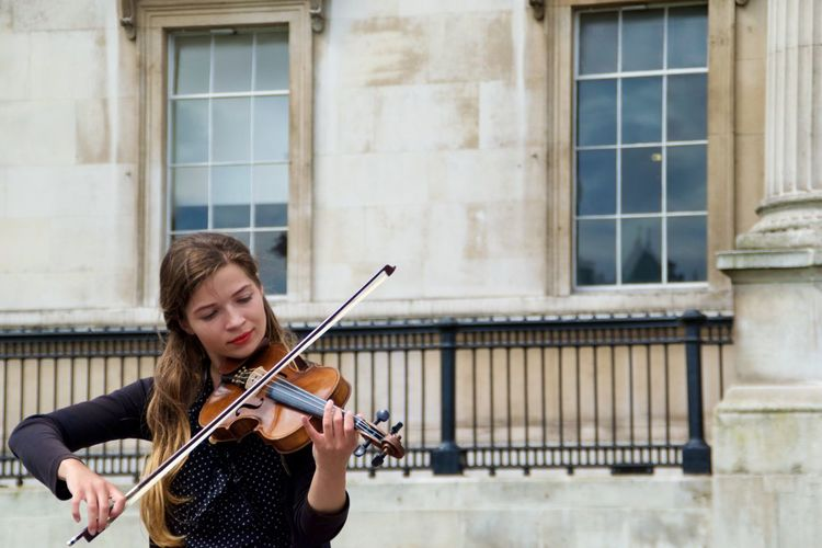Sound Of Life a Violinist performing in the streets of London . She is one of many Street Muscians who play Live Music for our pleasure in London. Capture The Moment