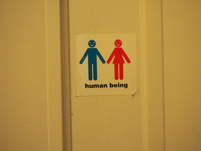 Close-up of restroom sign on door