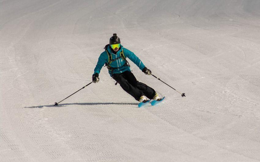 Full length of man skiing on snow