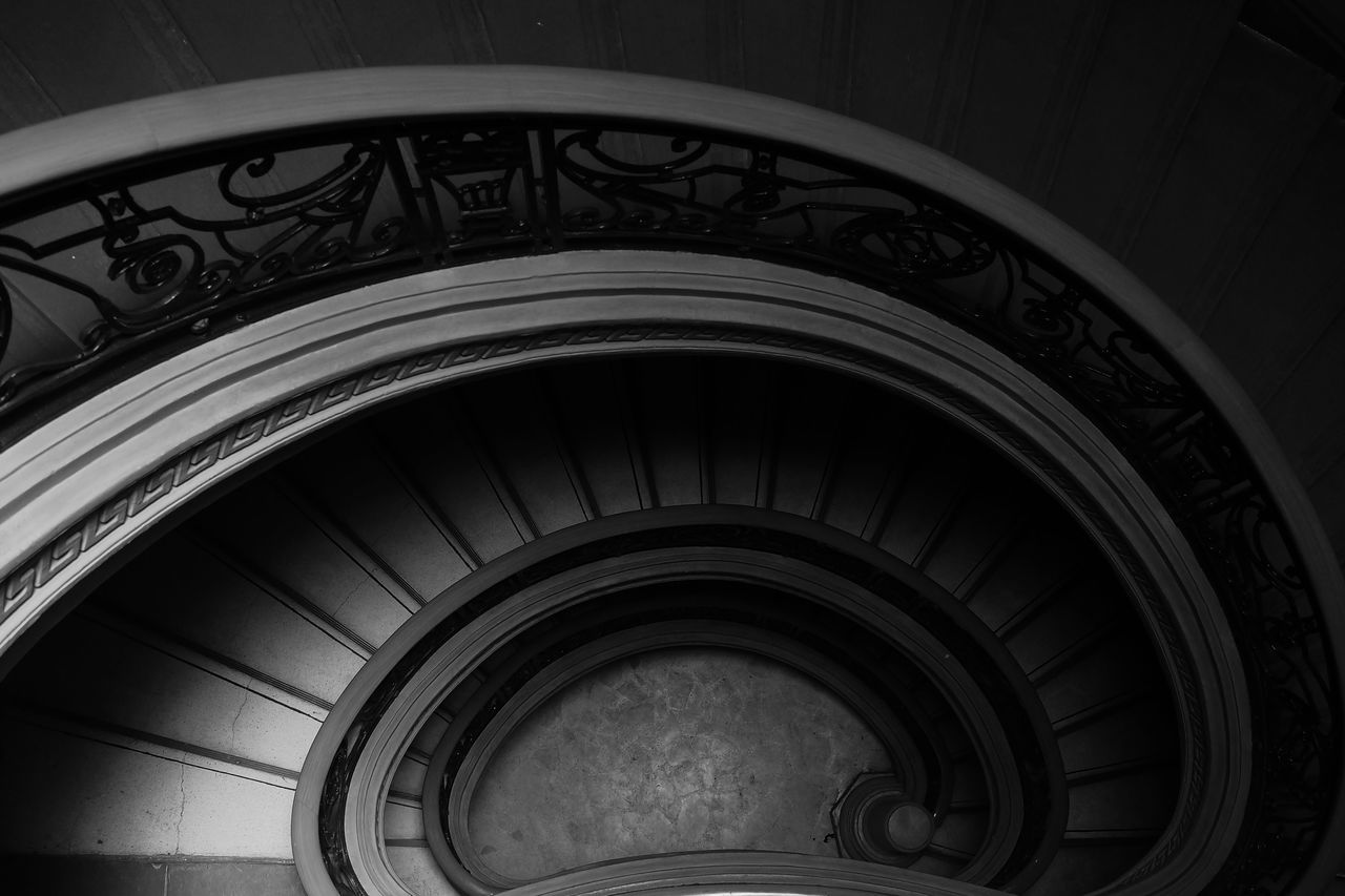 architecture, built structure, steps and staircases, staircase, railing, spiral, pattern, no people, indoors, spiral staircase, design, day, low angle view, building, shape, repetition, geometric shape, concentric