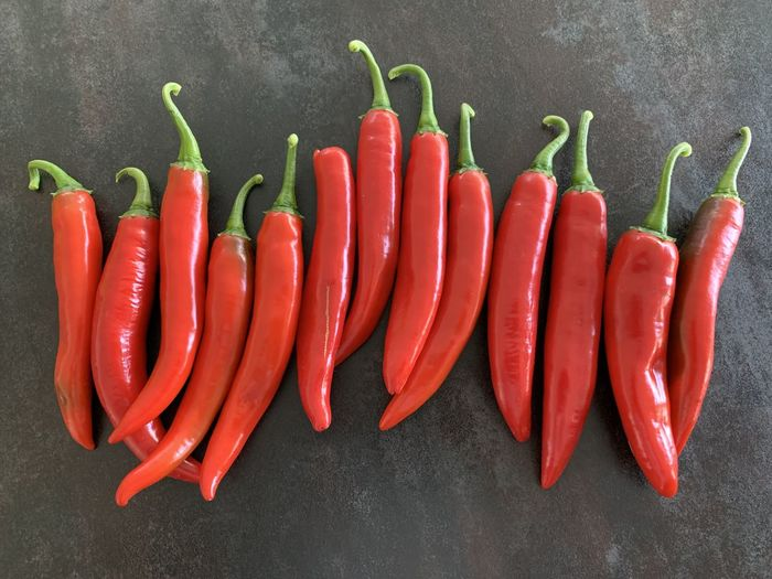 High angle view of red chili peppers on floor