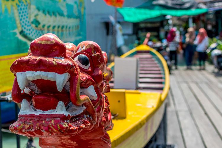 Dragon shape boat on boardwalk