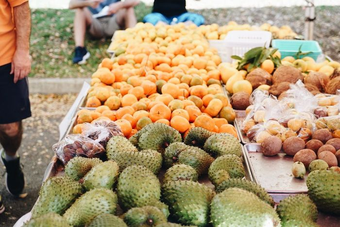 Food And Drink Abundance Freshness Retail  Healthy Eating Large Group Of Objects Food Variation Choice Market Incidental People Outdoors Market Stall Fruit Human Body Part Heap For Sale High Angle View Arrangement Day Hawaii Kailua  Morning Sony