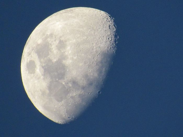 Close-up of moon against clear blue sky