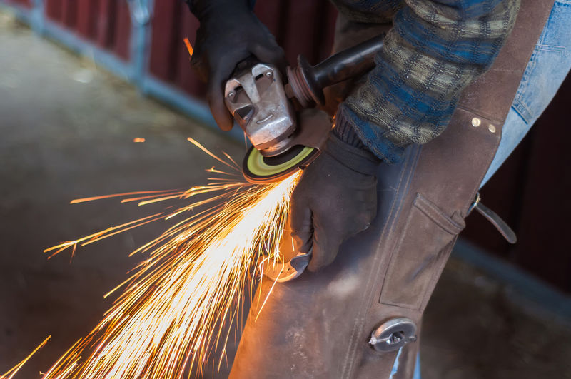 Blurred Motion Effort Factory Hand Holding Human Hand Industry Long Exposure Men Metal Metal Industry Midsection Motion Occupation One Person Real People Skill  Sparks Welding Working Workshop
