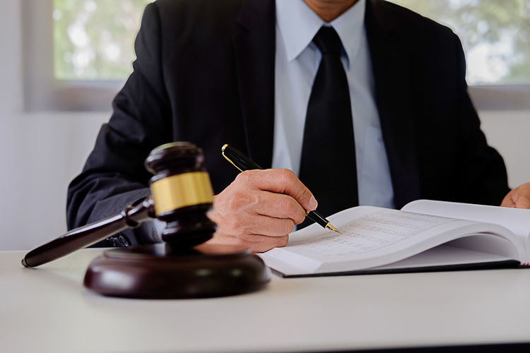 Lawyer working at desk in courtroom