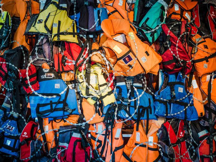Abundance Backgrounds Day Flüchtlinge Flüchtlingsboot Full Frame Large Group Of Objects Lifejackets No People Outdoors Stacheldraht