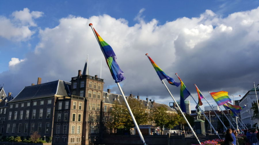 Multi colored flags against sky