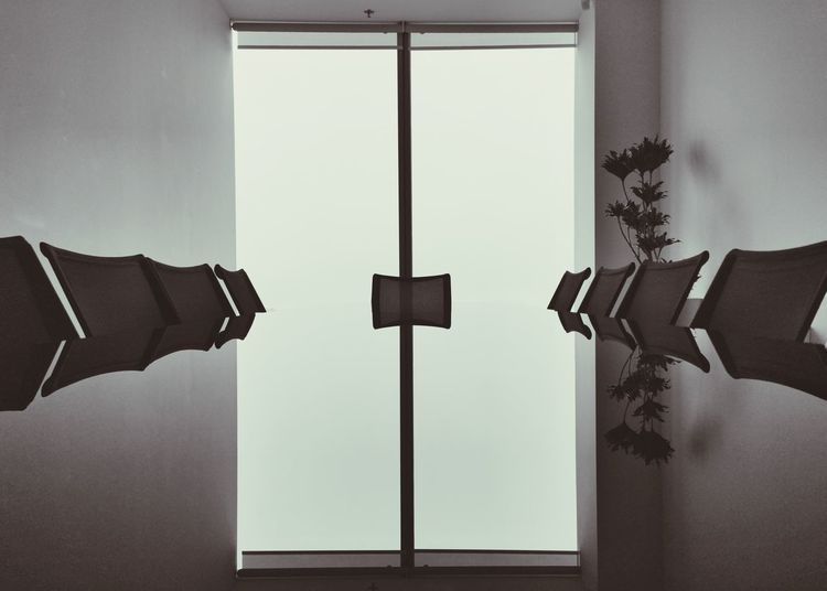 Midsection of man with closed door of building