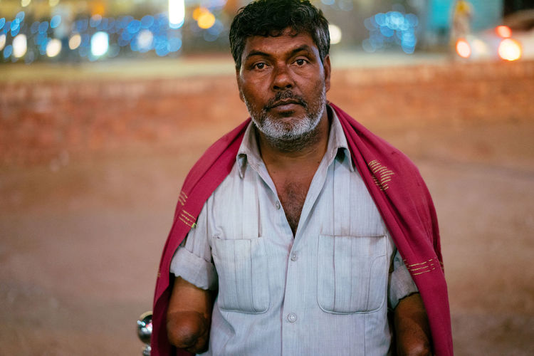 The Portraitist - 2018 EyeEm Awards Adult Casual Clothing City Facial Hair Focus On Foreground Front View Illuminated Leisure Activity Lifestyles Looking At Camera Males  Men Night One Person Portrait Real People Standing Street Waist Up This Is Strength