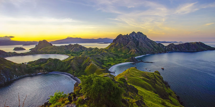 Aerial view of Flores island, indonesia Bali INDONESIA Aerial Beauty In Nature Cloud - Sky Environment Flores Idyllic Lombok Mountain Mountain Range Nature No People Non-urban Scene Outdoors Padar Plant Scenics - Nature Sea Sky Sunset Tranquil Scene Tranquility Travel Destinations Water