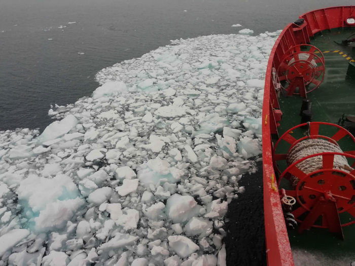 Transportation Water Day Mode Of Transportation No People Nature Winter Sea Outdoors Cold Temperature Beauty In Nature High Angle View Snow Scenics - Nature Engine Land Wheel Brash Ice Travel Travel Destinations Antarctica Ice Sailing Ocean Ice And Sea