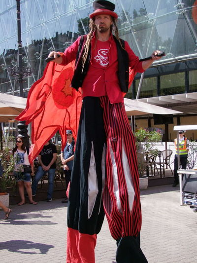Walking on Stilts Budapest Capital City Composition Full Frame Full Length Fun Hungary Indian Festival Leisure Activity Lifestyles Man One Man Only One Person Outdoor Photography Performer  Portrait Red And Black Colour Street Performer Tall Tourist Attraction  Travel Destination Walking On Stilts Young Adult
