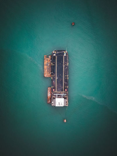High angle view of carrier ship floating on sea