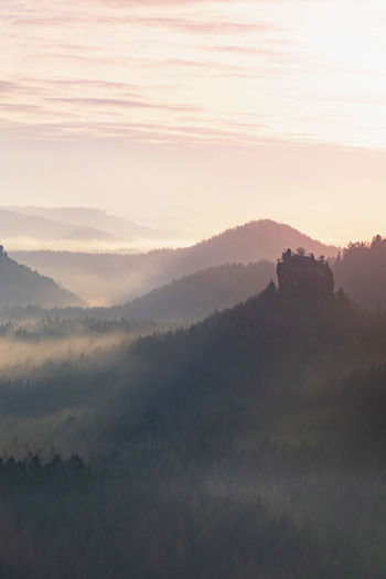 Magnificent heavy mist in faiyr landscape. autumn  sunrise in a countryside. hill increased from fog