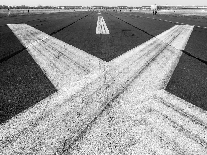 The former runway of airport Tempelhof in Berlin, Germany. Nowadays it is used as a large urban park. Asphalt Black And White City Park Day Outdoors Road Marking Runway Tempelhofer Feld Urban Landscape Vanishing Point Wide Angle X The Great Outdoors - 2016 EyeEm Awards