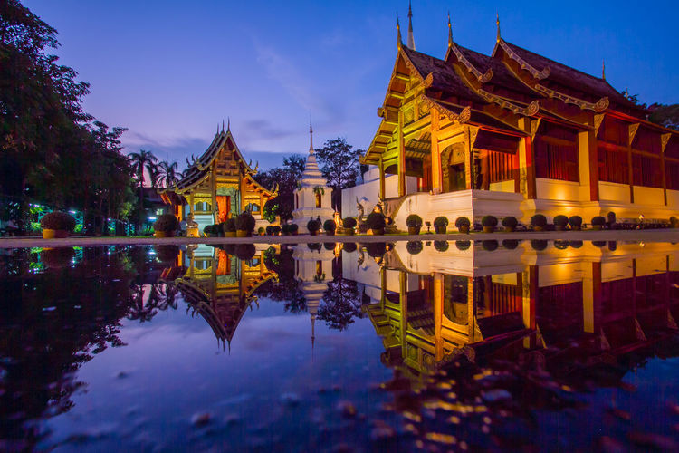 Night temple Wat Phra Singh Woramahawihan, Chiangmai, Thailand Wat Phra Singh Woramahawihan Architecture Building Exterior Built Structure Day Gold Colored Nature No People Outdoors Pagoda Place Of Worship Reflection Religion Sky Spirituality Travel Destinations Water Waterfront