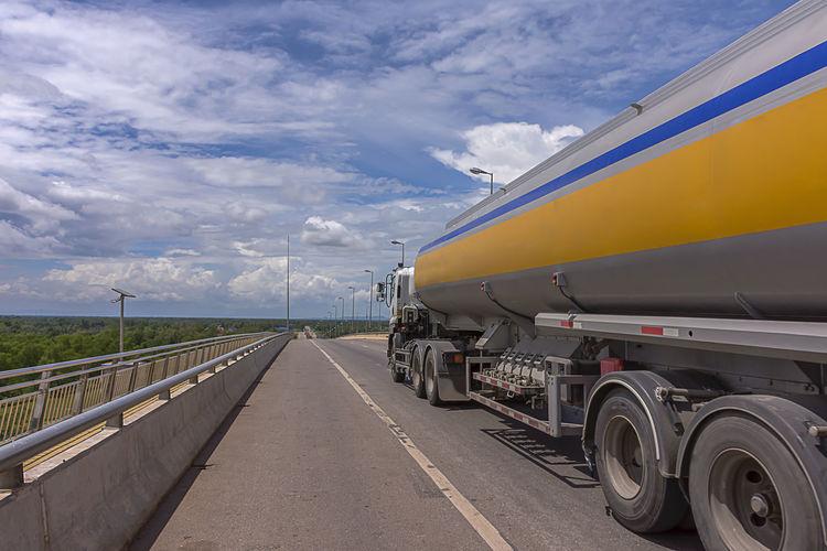 Fuel tanker on road against sky