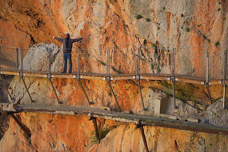 Person on footbridge