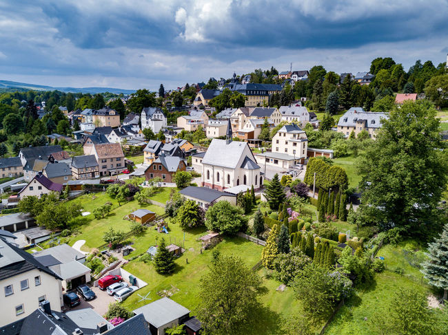 view of a small town in saxony Church Aerial View Architecture Building Building Exterior Built Structure City Cloud - Sky Clouds Environment Garden High Angle View Land No People Outdoors Plant Residential District TOWNSCAPE Tree