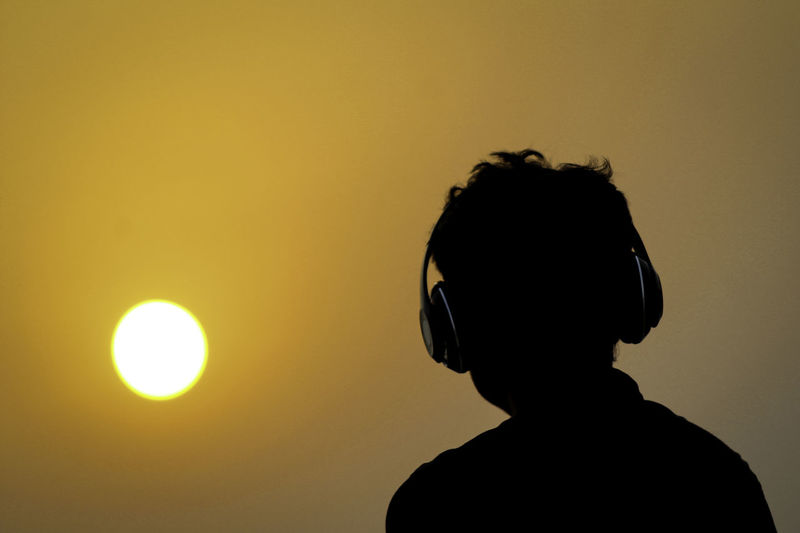 Silhouette of man with headphones on sunset sky of happy man listening music. Enjoying The View EyeEm Best Shots Listening To Music Music Lover Orange Sky Close-up Focus On Foreground Headshot Leisure Activity Lifestyles Males  Men Nature One Person Orange Color Outdoors Portrait Real People Rear View Silhouette Sky Sun Sunset Sunset #sun #clouds #skylovers #sky #nature #beautifulinnature #naturalbeauty #photography #landscape Yellow EyeEmNewHere HUAWEI Photo Award: After Dark Summer In The City Capture Tomorrow Humanity Meets Technology 17.62° Analogue Sound British Culture