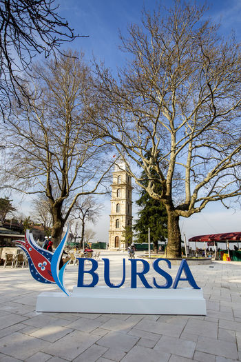 Architecture Bare Tree Blue Built Structure Bursa City City Life Cloud Day Information Information Sign No People Outdoors Saatkulesi Sky Tophane Travel Destinations Tree