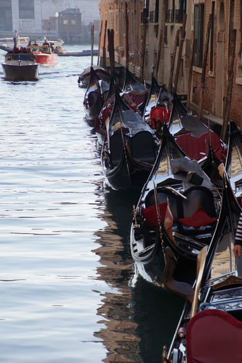 Gondolas at grand canal in city