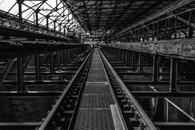 Railroad Track rail transportation track Transportation built structure the way forward diminishing perspective connection Architecture direction no people factory blackandwhite Railroad Track rail transportation track Transportation built structure the way forward diminishing perspective connection Architecture direction no people metal bridge bridge - man made structure day outdoors Trave Black And White Urban Geometry History Historic Urban Urban Exploration Factory Blackandwhite Railroad Track Rail Transportation Track Transportation Built Structure The Way Forward Diminishing Perspective Connection Architecture Direction No People Metal Bridge Bridge - Man Made Structure Outdoors Travel Long Empty Road Pathway Straight Historic Building vanishing point The Architect - 2019 EyeEm Awards My Best Photo The Traveler - 2019 EyeEm Awards