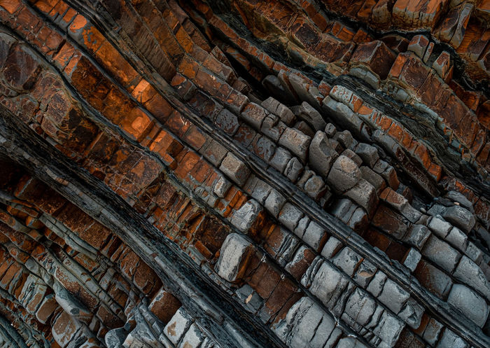 LOW ANGLE VIEW OF BRICK WALL WITH STONE