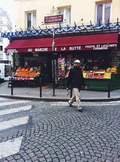 Full length of man walking on street in city