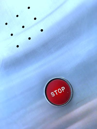Stop button in an elevator. Communication Push Button No People Urgency Button Technology Copy Space Divorce Break Up End Stop Alarm Emergency Crisis Stop Switch Stop Button Red