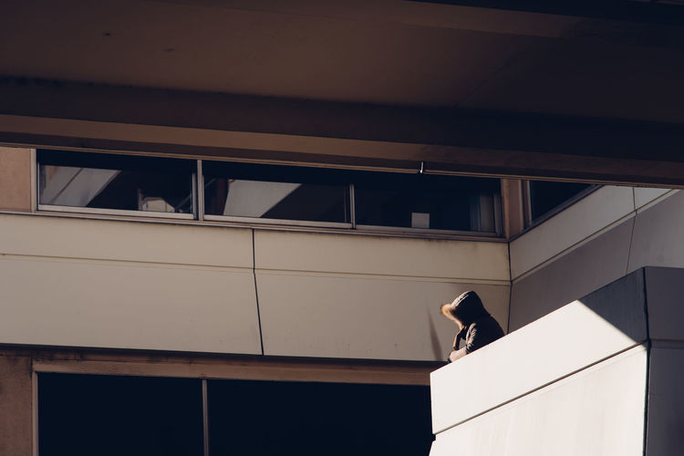 Real People One Person Watching Looking Cold Temperature Balcony EyeEm Selects Occupation Politics And Government Business Finance And Industry Architecture Guarding Security Guard Office Building Exterior Office Block Residential Structure Façade Building Place Of Interest Pediment Tall