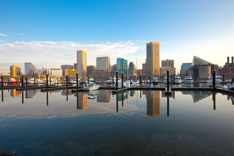 Downtown city skyline, Inner Harbor and marina, Baltimore, Maryland, USA Baltimore Downtown Harbor Inner Harbor Maryland Architecture Building Exterior Built Structure City Cityscape Dawn Modern Reflection Skyscraper Sunrise Travel Destinations Urban Skyline Waterfront