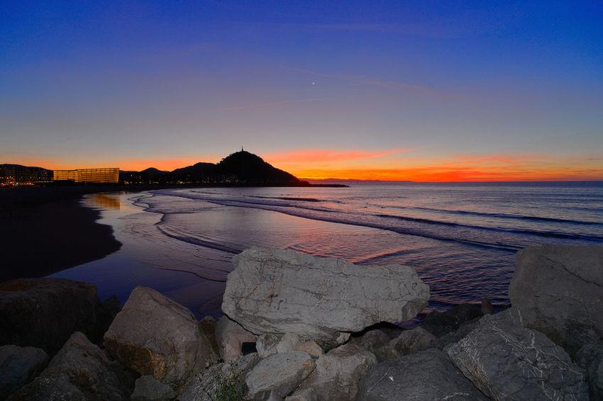 Sunset in the Zurriola beach. Beach Beauty In Nature Day Donostia / San Sebastián Nature No People Outdoors Reflection Rock - Object Scenics Sea Sky Sunset Water Zurriola Beach