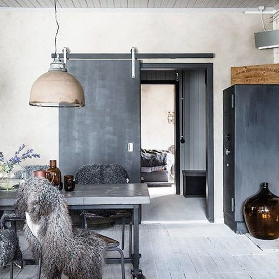 Suprisingly warm & Cozy Industrial Space ...I always add Sheepskins to my seating. Textures Scandinavian Design Interior Gray Rustic Home Sweden image via @myscandinavianhome