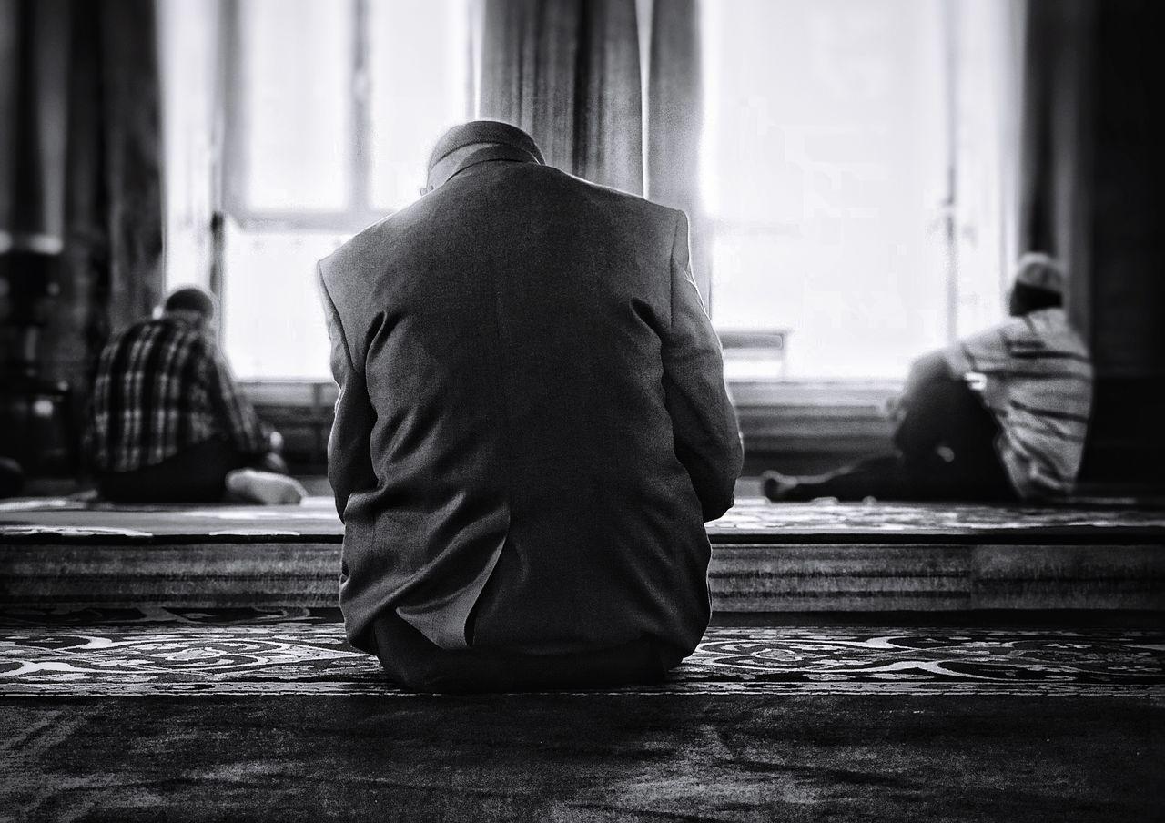 Men sitting in mosque