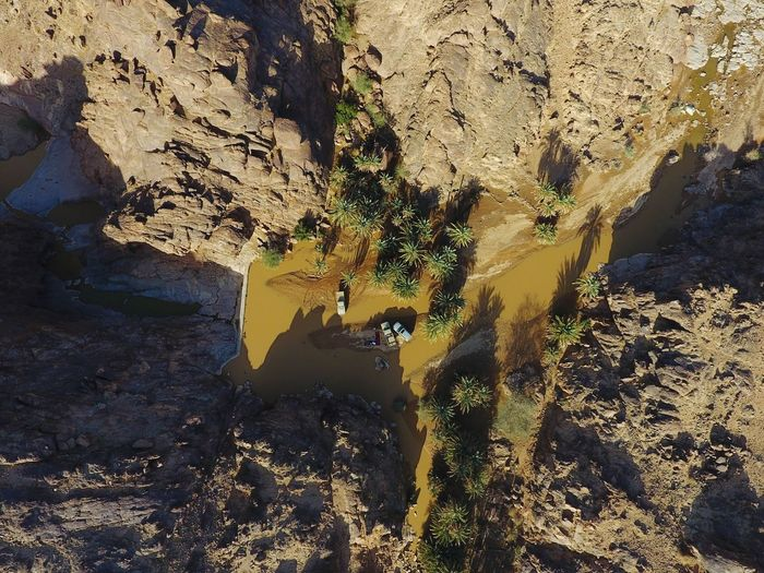 Aerial View Of Rock Formations And Shallow River During Sunny Day