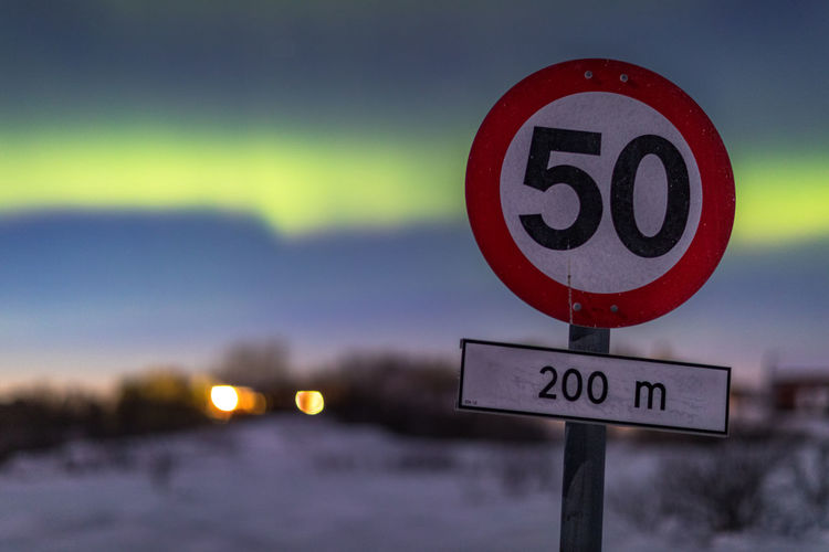 Northern Lights Northern Norway Norway Vesterålen Winter Circle Close-up Communication Day Focus On Foreground Geometric Shape Guidance Information Information Sign Nature No People Number Outdoors Road Road Sign Shape Sign Sky Snow Text Western Script The Traveler - 2018 EyeEm Awards