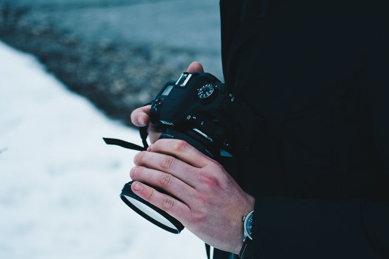 Photographer My Best Photo Holding Technology One Person Photography Themes Men Digital Camera Real People Photography Taking Photos Camera Photographer Outdoors Hobby Winter Photography Hobby Photography