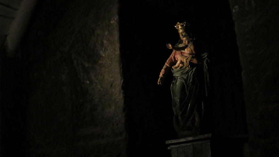 Statue of Maria and baby Jesus in the Saltmines of Kraków, Poland Art Baby Jesus Creativity Dark History Human Representation In Front Of Jesus Low Light Maria Place Of Worship Religion Sculpture Spirituality Statue Statue Stone Underground