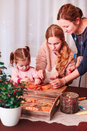 Family preparing gingerbread cookies at home