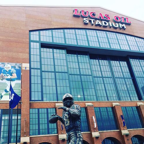 Lucas Oil Stadium Peyton Manning NFL Football NFL Lucas Oil Indianapolis  Coltsnation Colts Building Exterior Built Structure Architecture Day Representation Art And Craft Sculpture Human Representation No People Text Male Likeness Window Lifestyles City Leisure Activity Building Creativity Swimming Pool