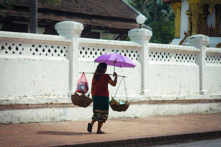 Full length of a street vendor walking