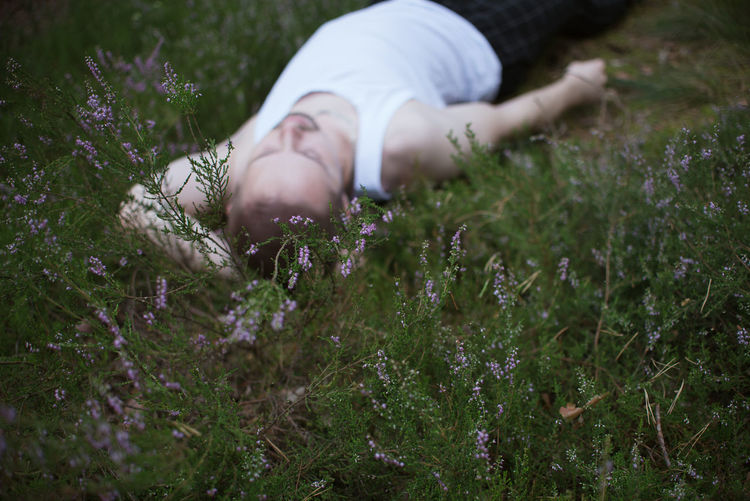Midsection of woman lying down on field