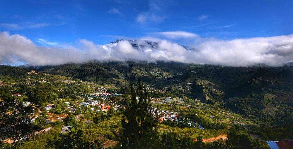 Ranau,Sabah-Feb 21,2017: Beautiful view of Kundasang Village with background mount Kinabalu during morning.Kundasang is the vegetable capital of Sabah. Nature Tree Cloud - Sky Sky Outdoors No People Travel Destinations Beauty In NatureLandscape Colour Of Life Sabahmalaysia