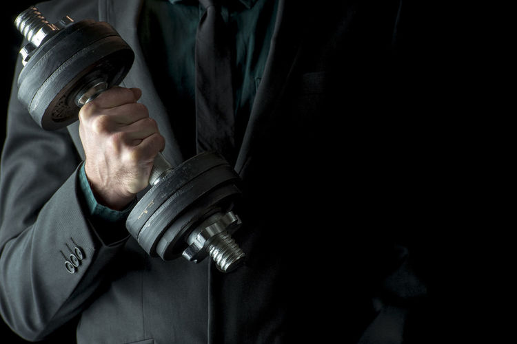 Close-up of man holding camera