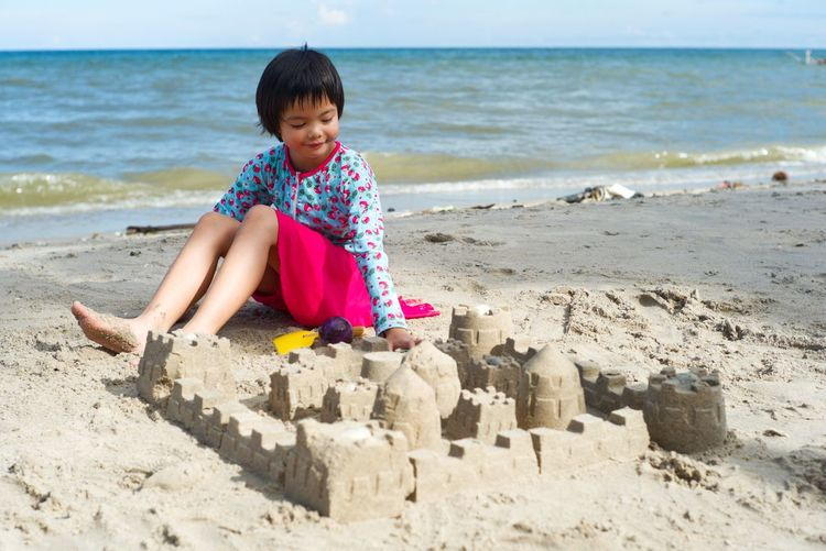 Portrait Asian girl building the sandcastle on the beach Happy Fun Sea Beach Bacation EyeEm Selects Land Sea Childhood Beach Child Water Leisure Activity Sand Casual Clothing Real People One Person Sitting Nature Horizon Over Water Sandcastle Outdoors Lifestyles Girls
