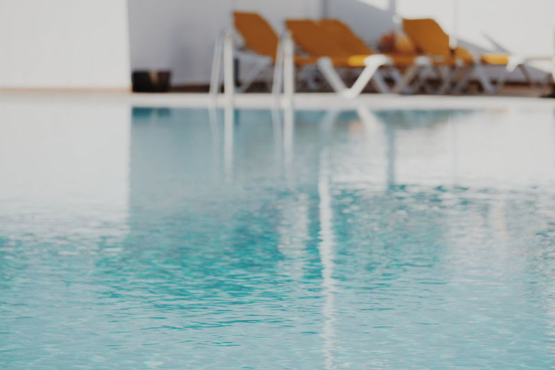 by the pool Pool Poolside Water Reflection Backgrounds Background Water Swimming Pool Sea Reflection Built Structure Infinity Pool Refraction Poolside Resort Deck Chair Sun Lounger Pool Tourist Resort Luxury Hotel Health Spa Lounge Chair Spa Holiday Villa Calm